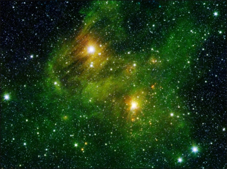 Two extremely bright stars illuminate a greenish mist in this and other images from the new GLIMPSE360 survey.